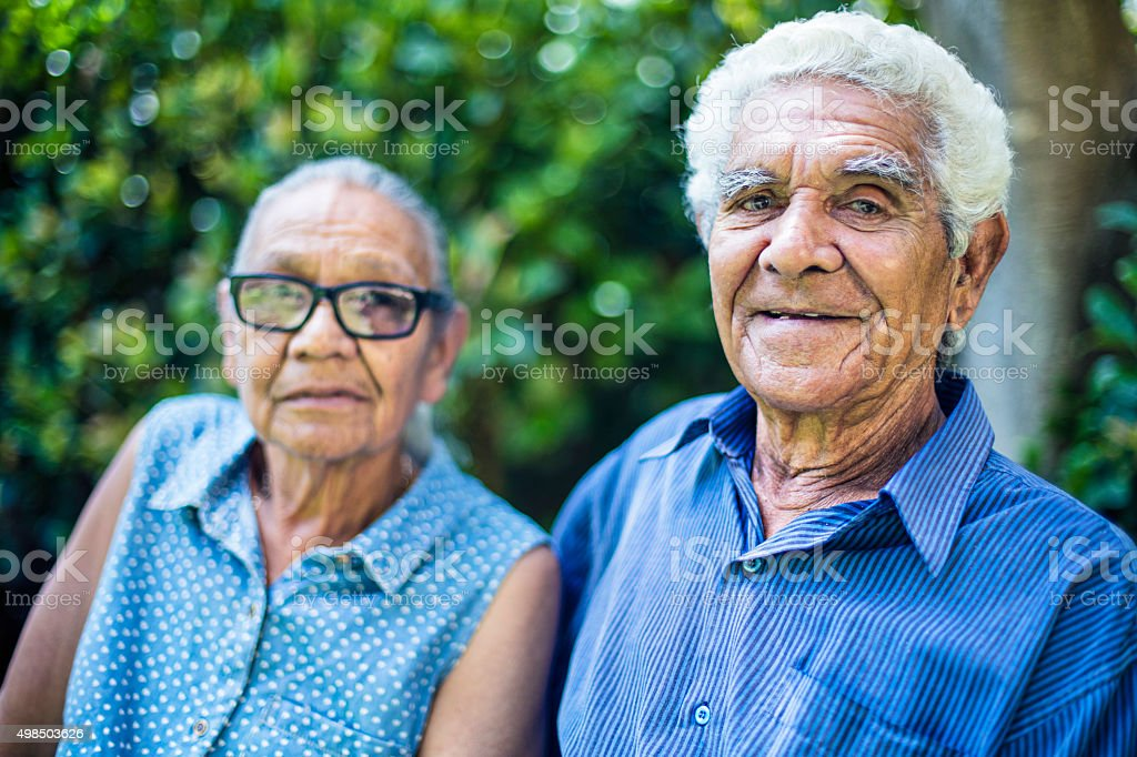 Happy aboriginal senior couple portrait stock photo