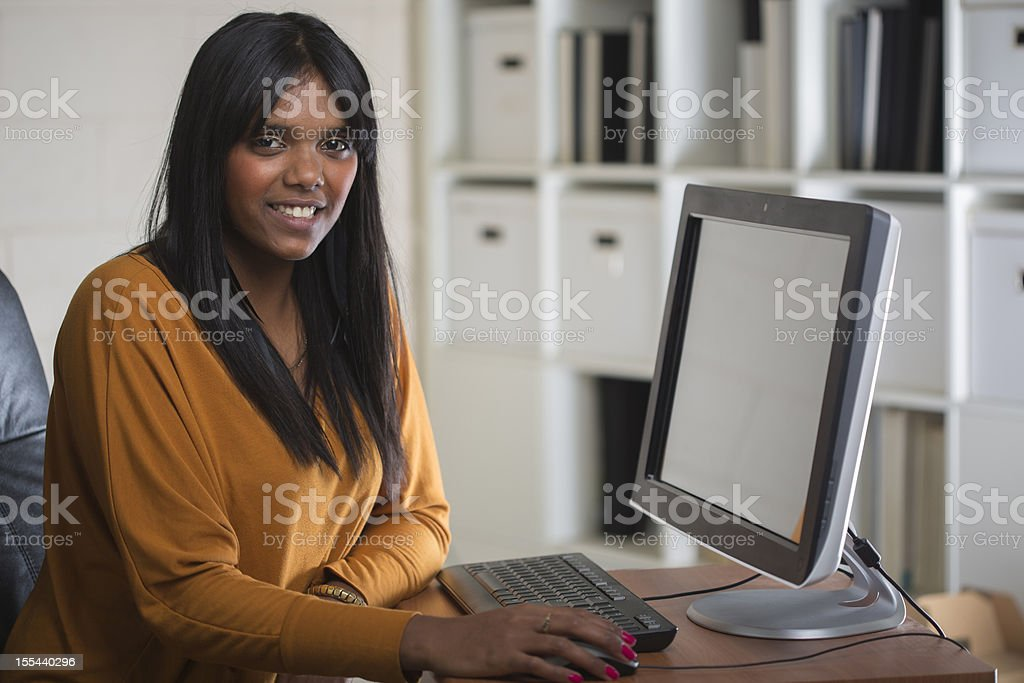 Happy Aboriginal Woman at Work stock photo