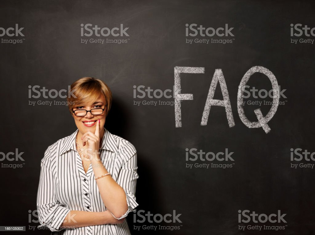 Happy about FAQ on the Blackboard stock photo
