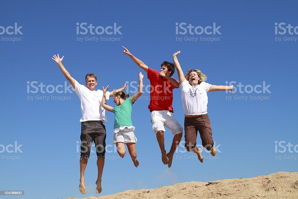 happy active family jumping royalty-free stock photo