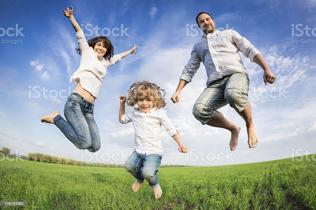 Happy active family jumping stock photo