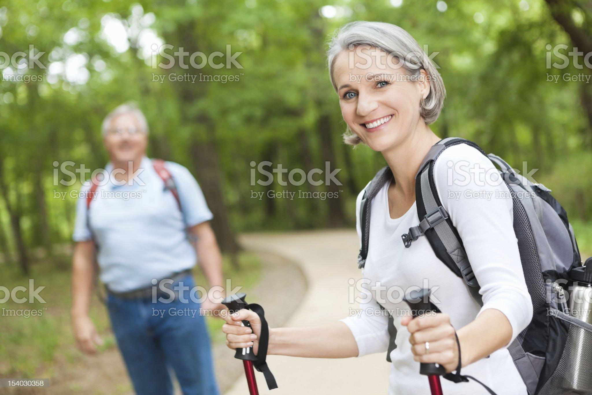 Happy active senior couple hiking together enjoying retirement royalty-free stock photo