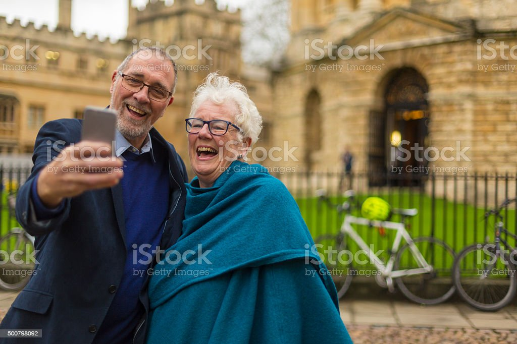 Happy Active Senior Couple Taking a Selfie in Oxford, England stock photo