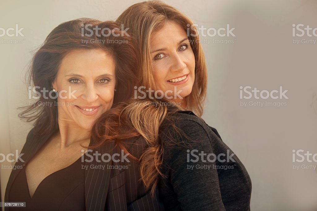 Happy adult business women smiling stock photo