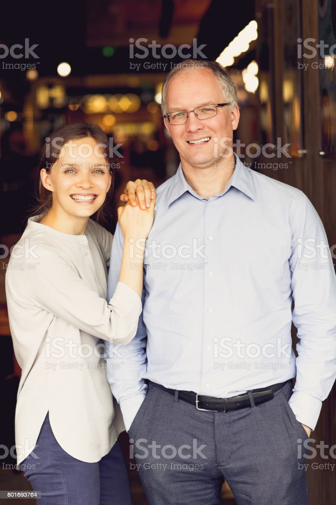 Happy Adult Daughter and Middle-aged Father stock photo
