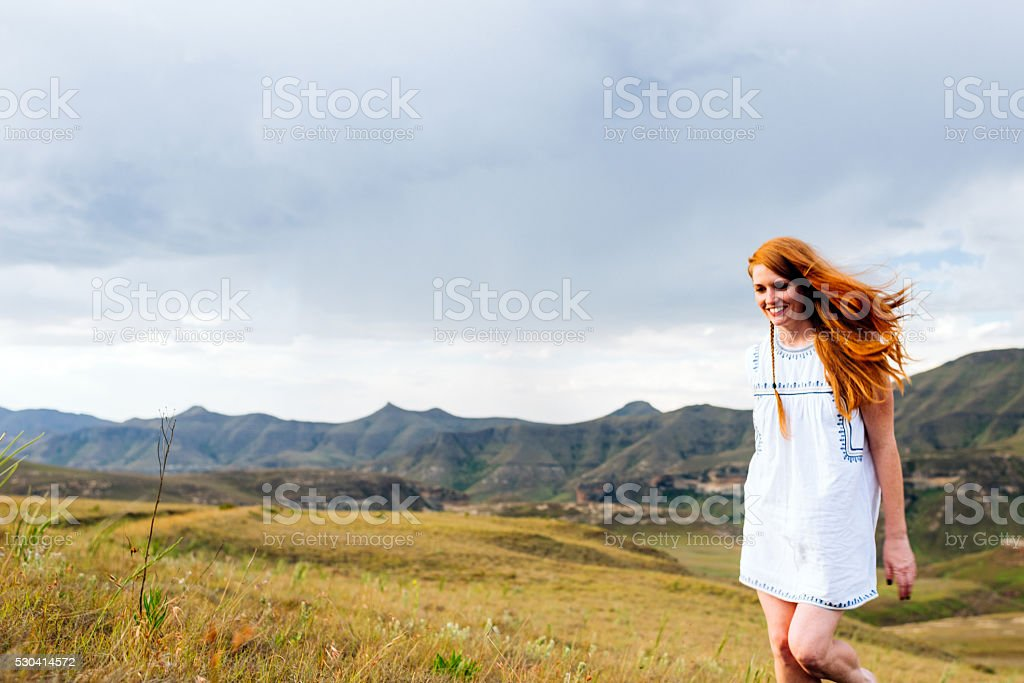 Happy Adult Woman Walking Alone In Countryside stock photo