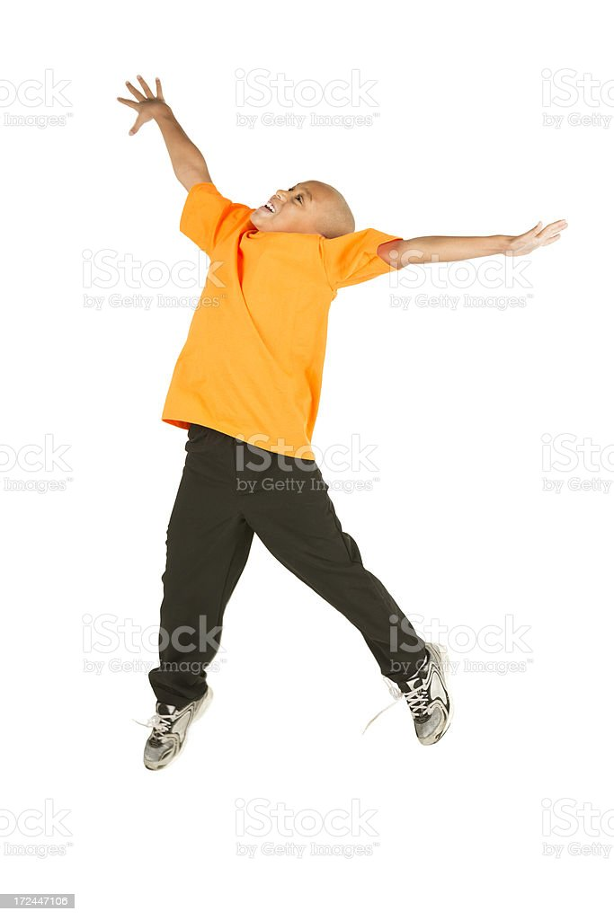 Happy african american boy jumping on white stock photo