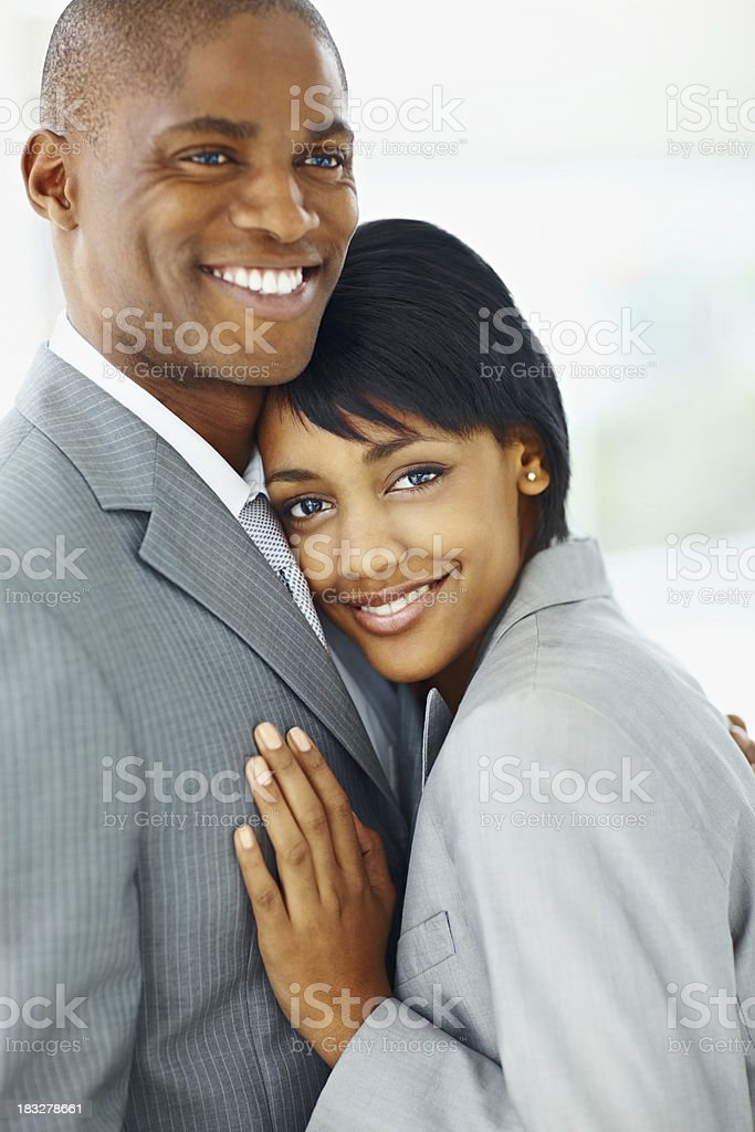 Happy African American business couple hugging royalty-free stock photo