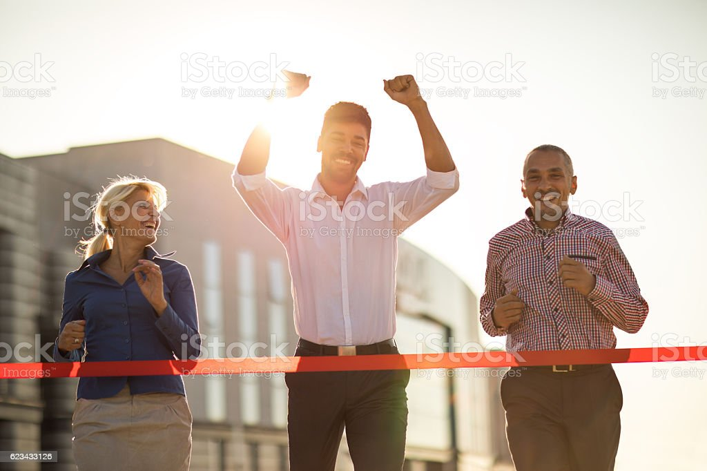 Happy African American businessman celebrating his victory in the race. stock photo
