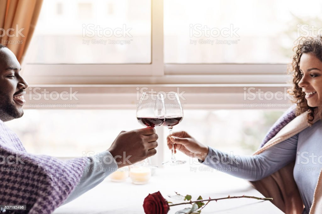 Happy African American couple drinking wine in the restaurant stock photo