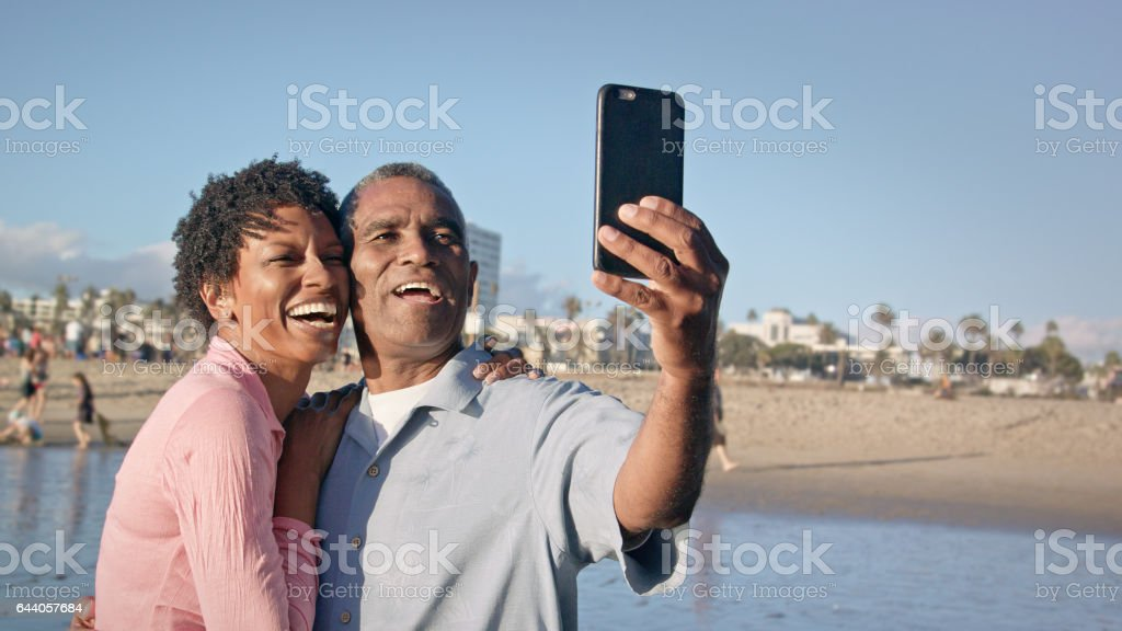 Happy African American Couple take Selfie on Beach stock photo