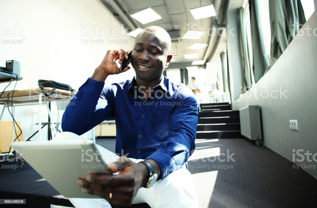 happy african american entrepreneur using tablet computer. stock photo