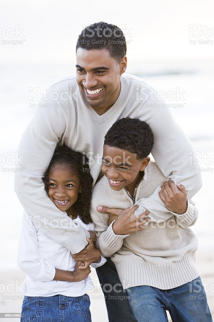 Happy African American father and kids outdoors royalty-free stock photo