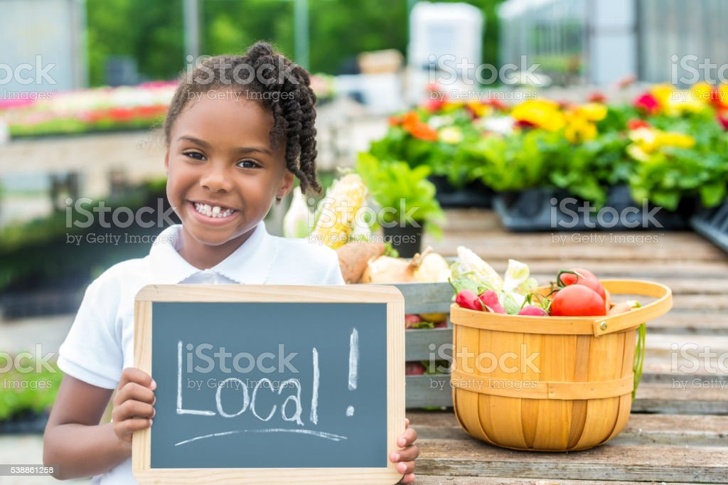 Happy African American Girl holding local sign stock photo
