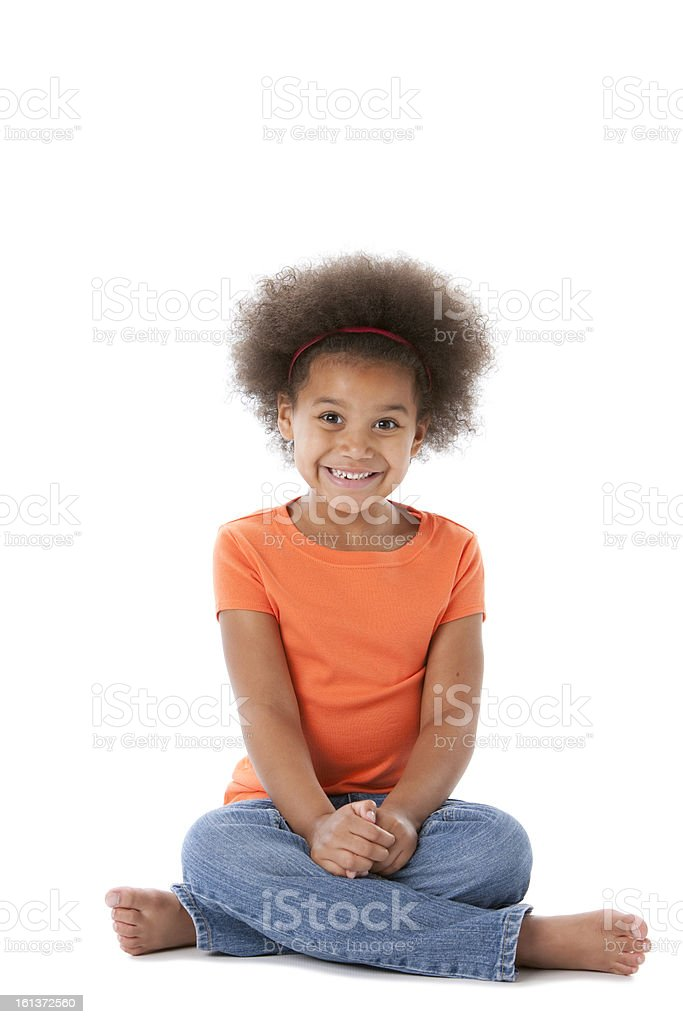 Happy African American Little Girl Sits in Anticipation stock photo
