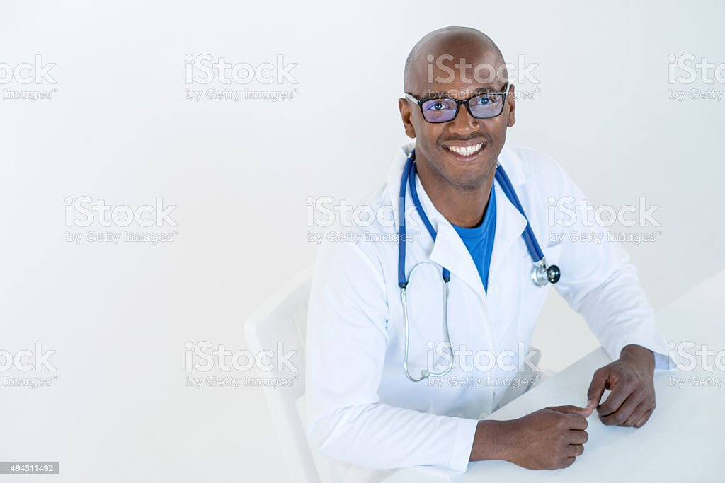 Happy African American male doctor stock photo