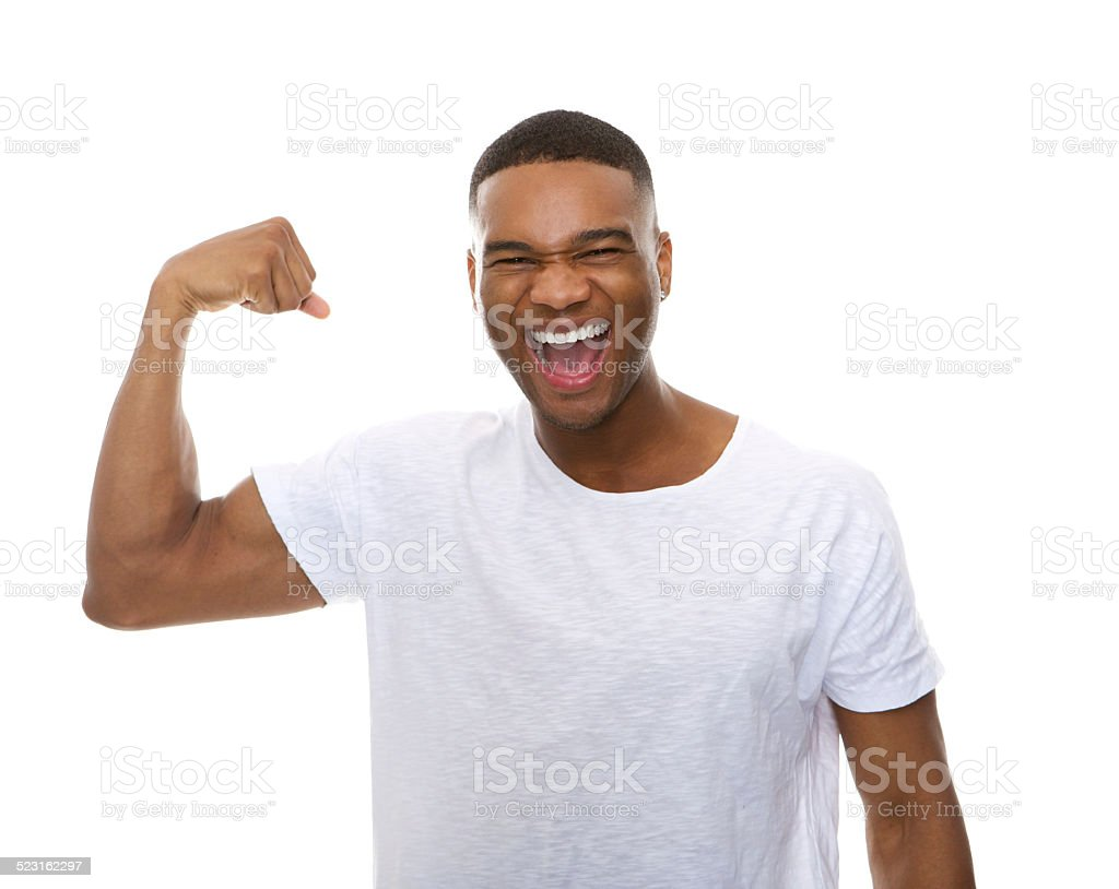 Happy african american man flexing arm muscle stock photo