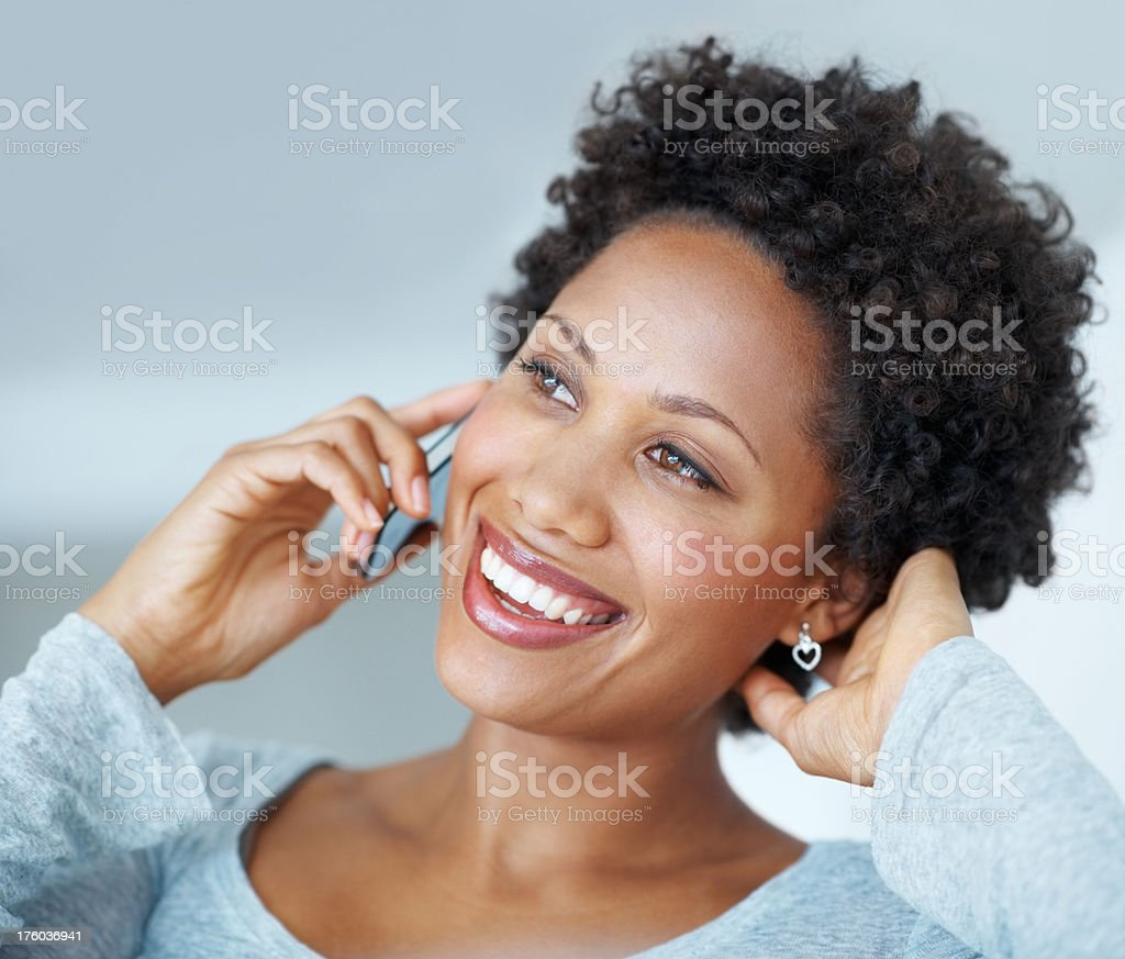 Happy African American woman on phone stock photo