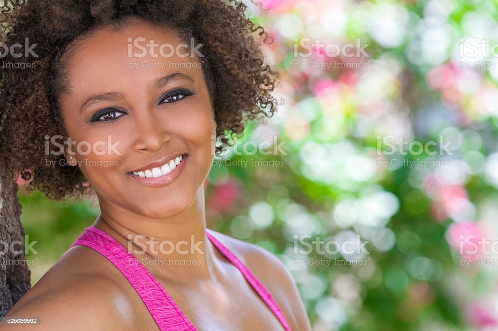 Happy African American Woman Smiling Outside stock photo