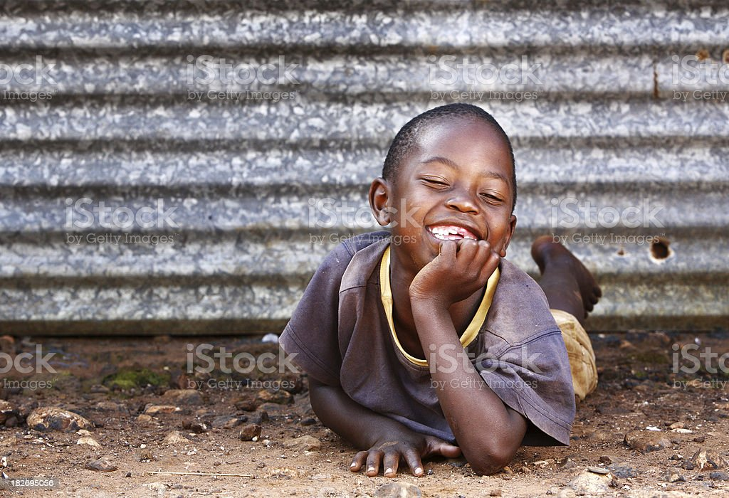 Happy African boy relaxing royalty-free stock photo