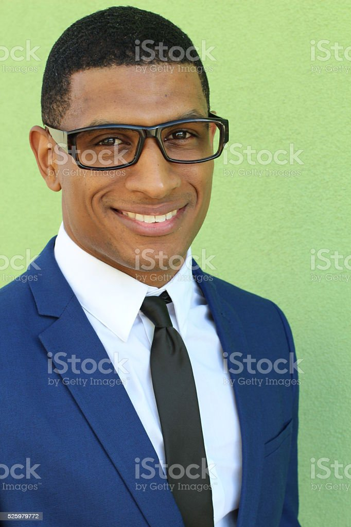Happy african businessman in a blue suit stock photo