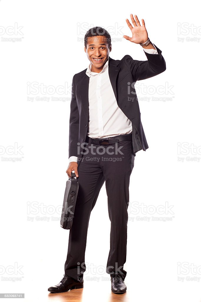 Happy african businessman waving his hand stock photo