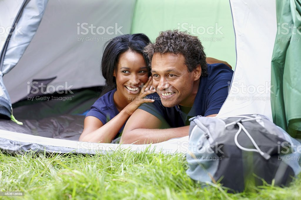 Happy african couple camping outdoors royalty-free stock photo