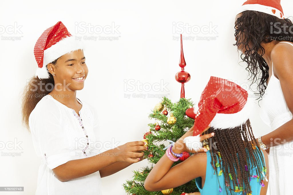 Happy African Family Decorating Christmas Tree. royalty-free stock photo