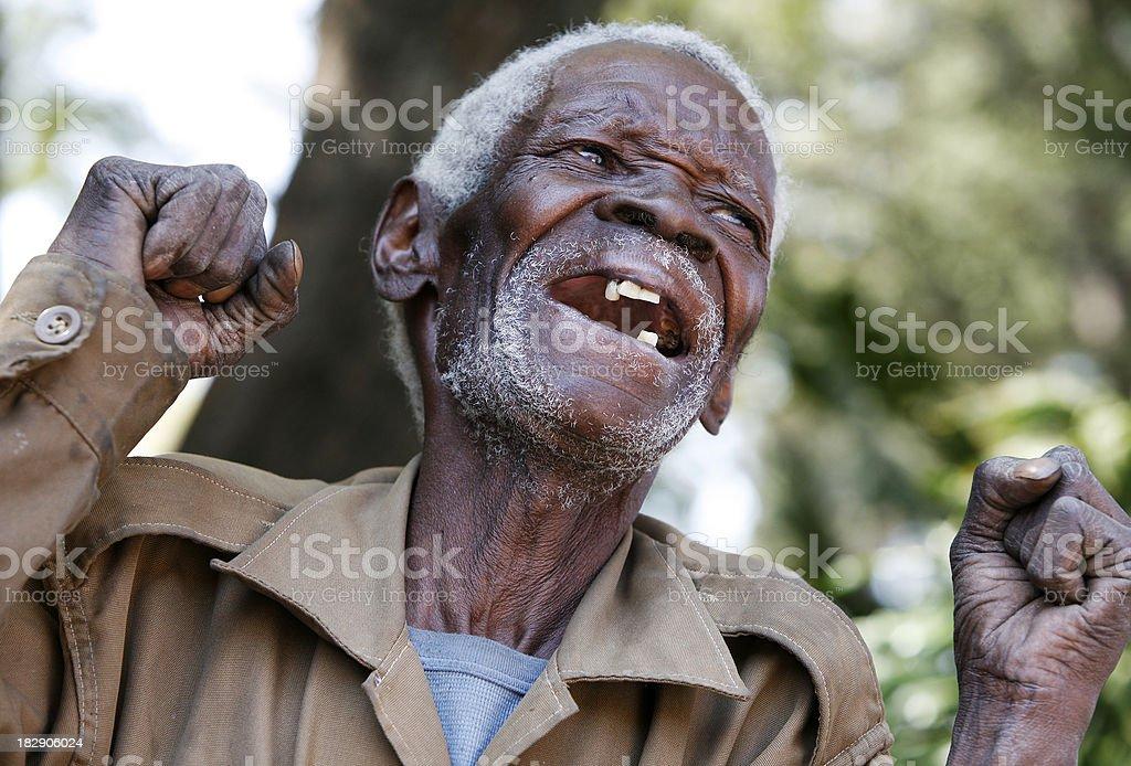 Happy African man celebrating royalty-free stock photo