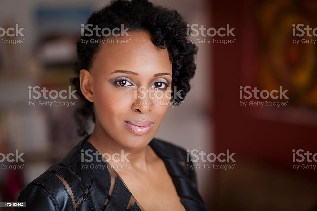 Happy African Woman Smiling At The Camera stock photo