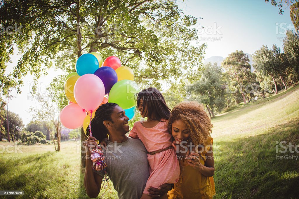 Happy African-American family spending quality time in a sunny p stock photo
