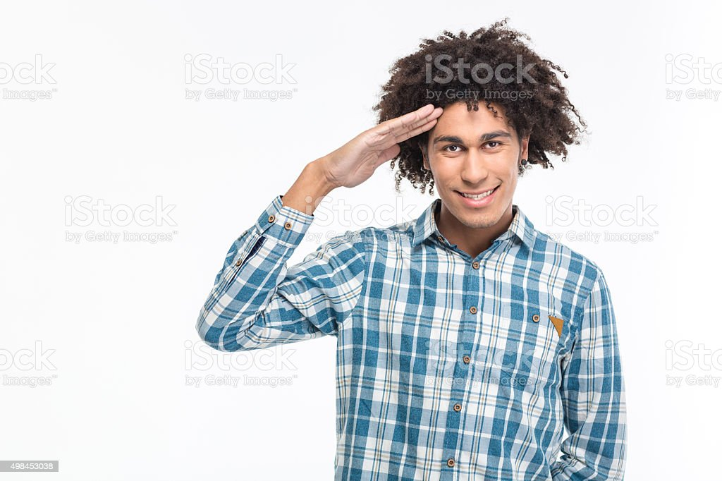 Happy afro american man saluting stock photo