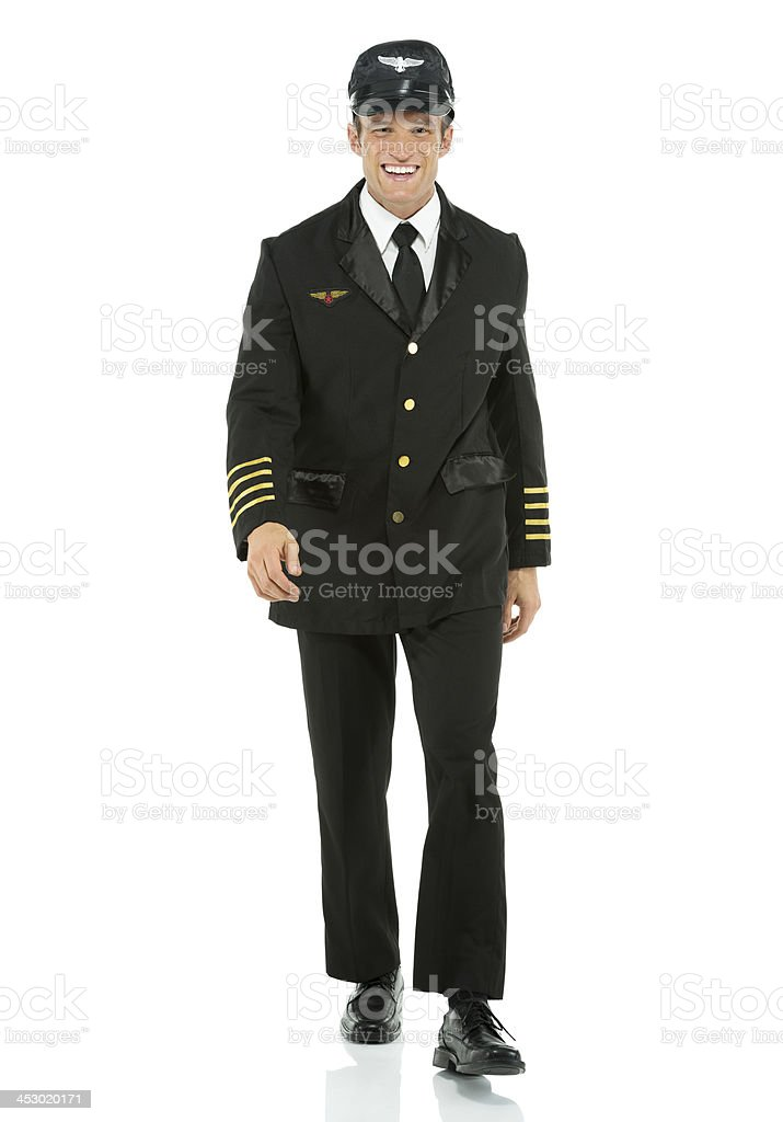 Happy airline pilot walking royalty-free stock photo