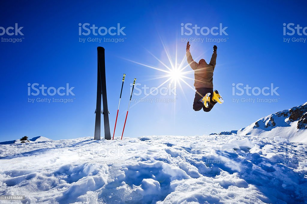 Happy alpine skier jumping in air on the top royalty-free stock photo