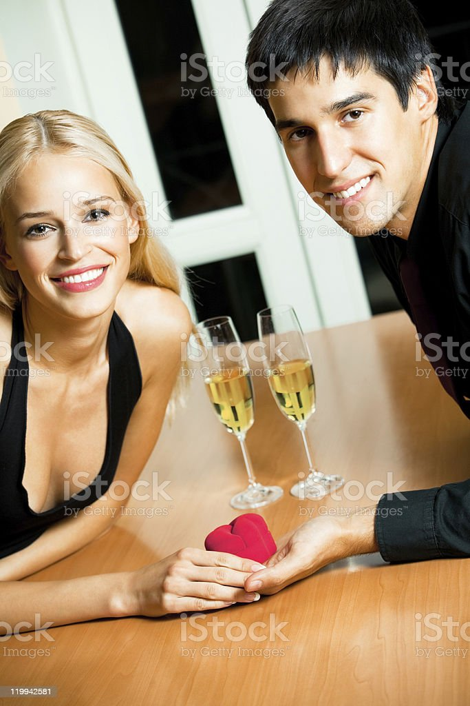 Happy amorous couple and a special man proposal in restaurant royalty-free stock photo