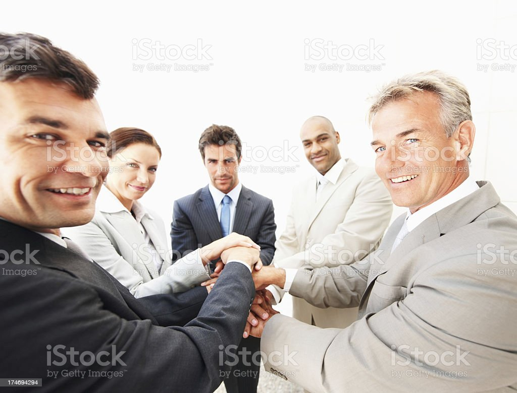 Happy and cheerful business people joining hands royalty-free stock photo