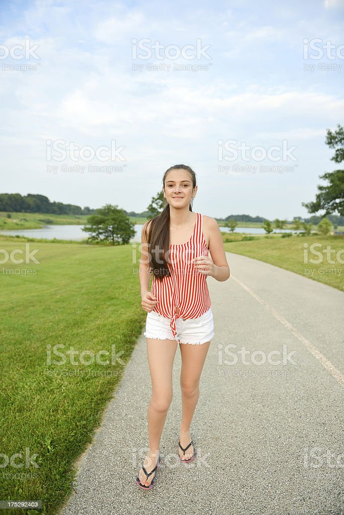 Happy and healthy woman walking/running in the park royalty-free stock photo