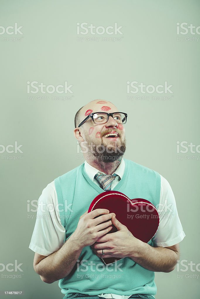 Happy and in Love Nerd holding Heart royalty-free stock photo