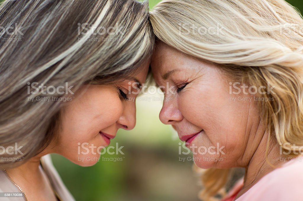 Happy and loving mother and daughter face to face stock photo