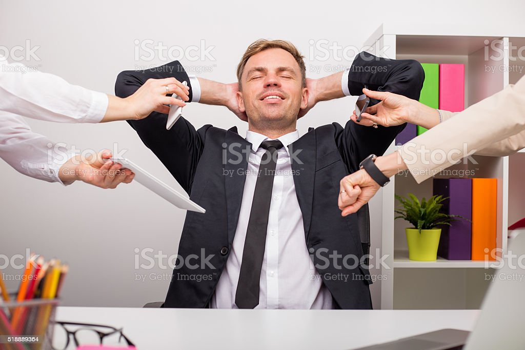 Happy and relaxed man at the office stock photo