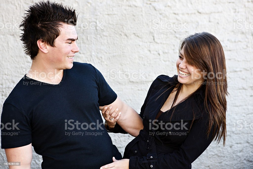 Happy and relaxed, this young couple laugh together royalty-free stock photo
