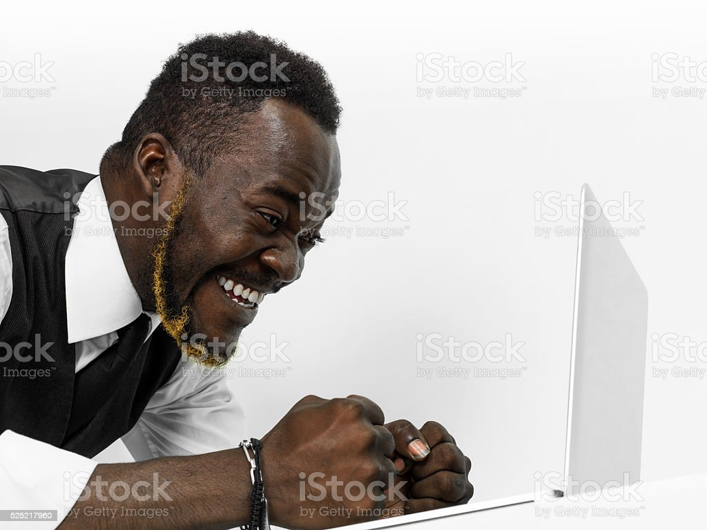 Happy and satisfied businessman portrait looking at news on lapt stock photo
