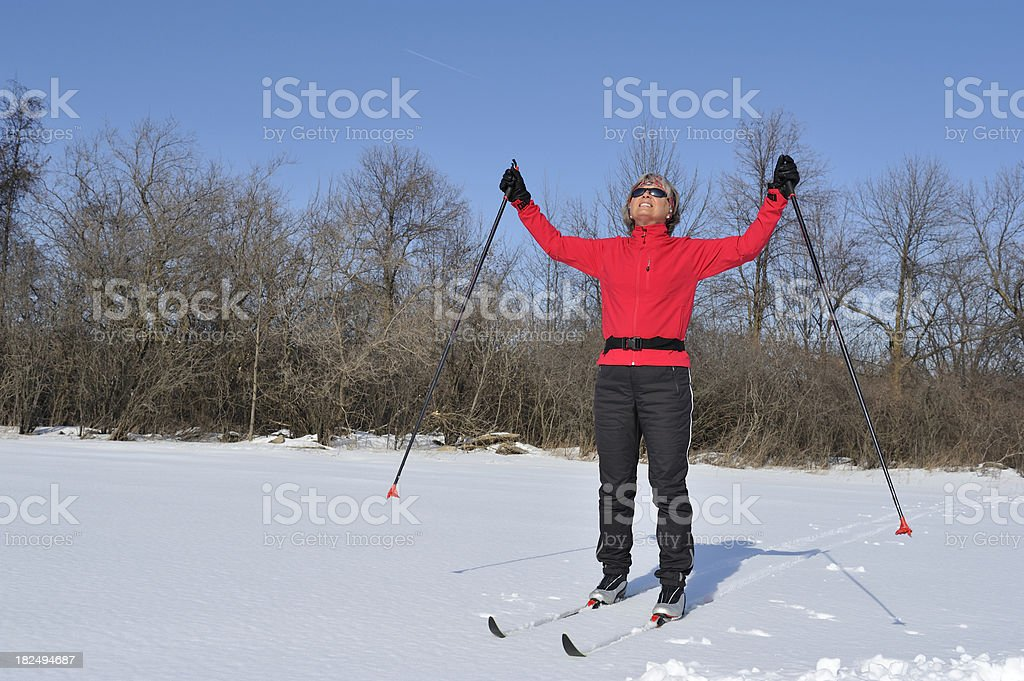 Happy and smiling woman, cross-country skiing, winter sport royalty-free stock photo