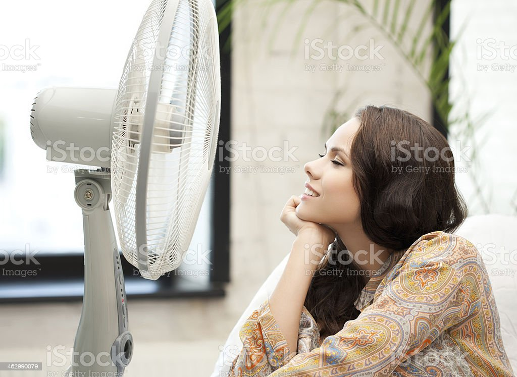happy and smiling woman sitting near ventilator stock photo