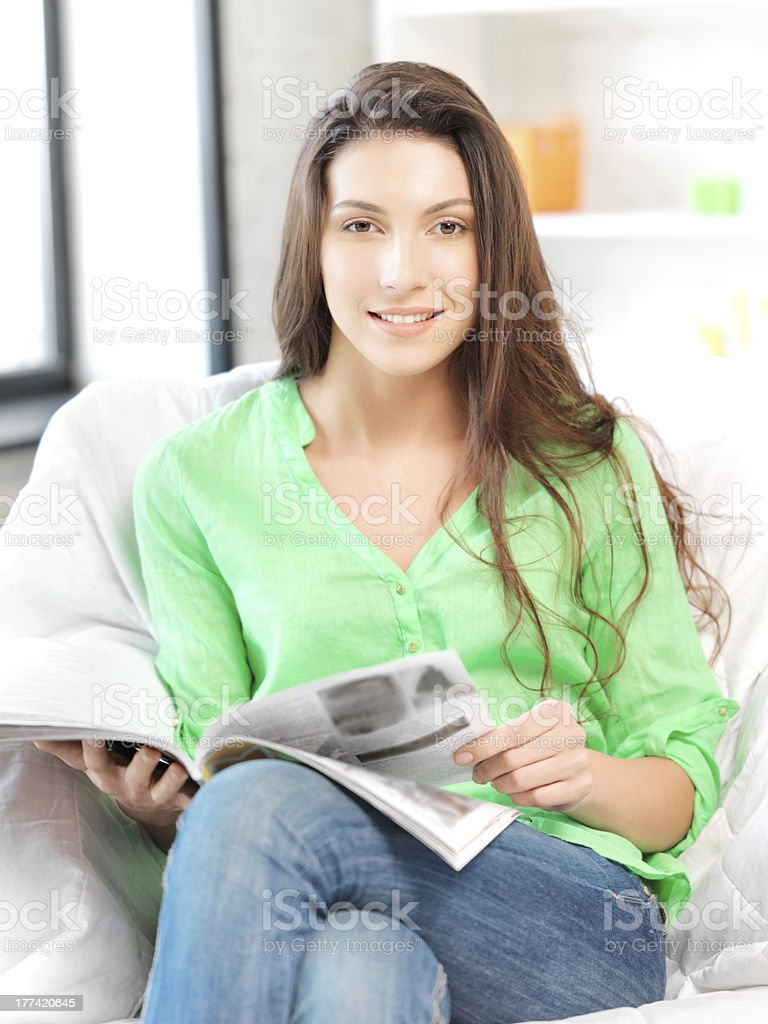 happy and smiling woman with magazine royalty-free stock photo