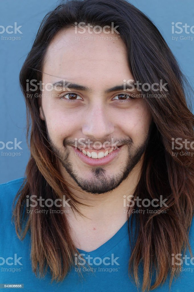 Happy and smiling young man's portrait stock photo