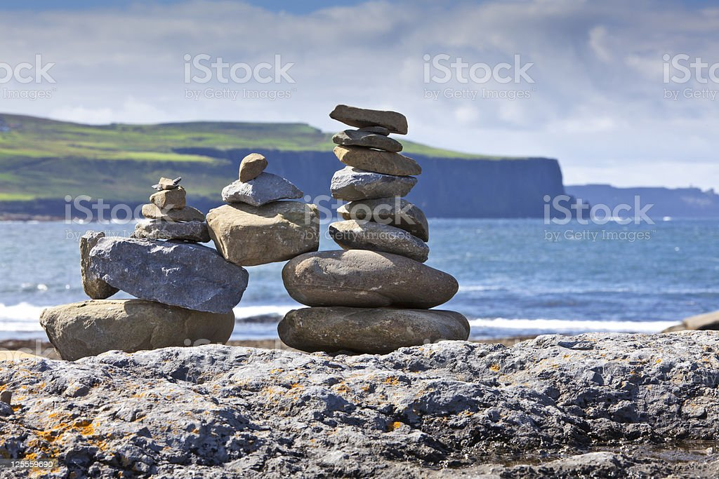 Happy and Stable Stone Family . stock photo