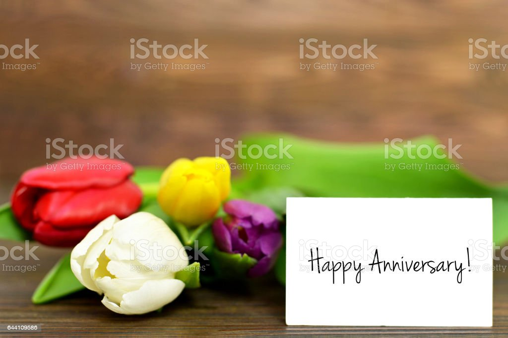 Happy Anniversary card and tulips stock photo