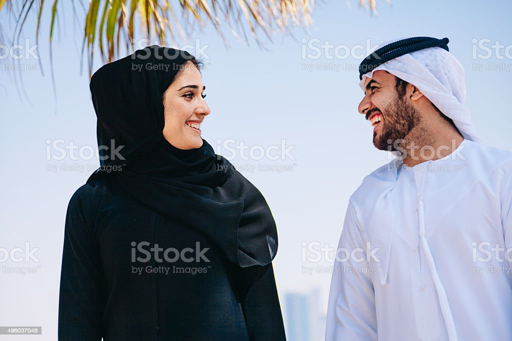 Happy Arab Couple enjoying at beach stock photo