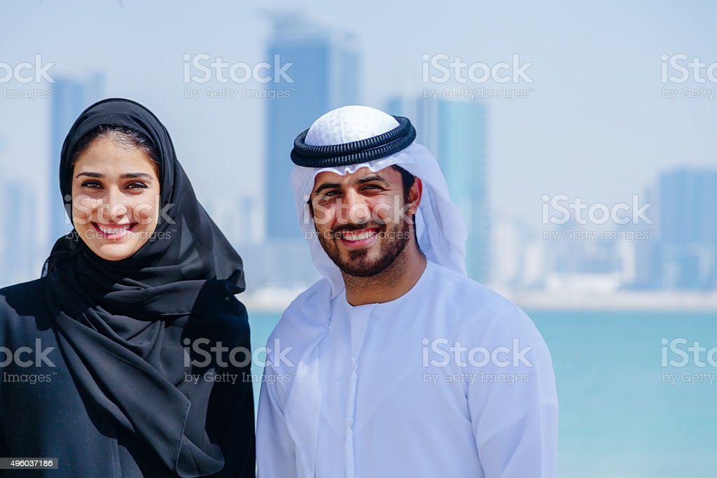 Happy Arab Couple enjoying at beach stock photo